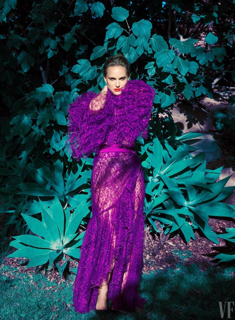 Actress Natalie Portman poses in a purple Rodate dress