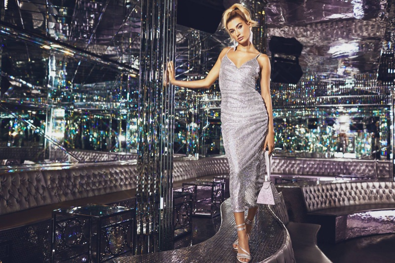 Model Hailey Baldwin wears PrettyLittleThing Silver Sequin Wrap Over Midaxi Dress $75