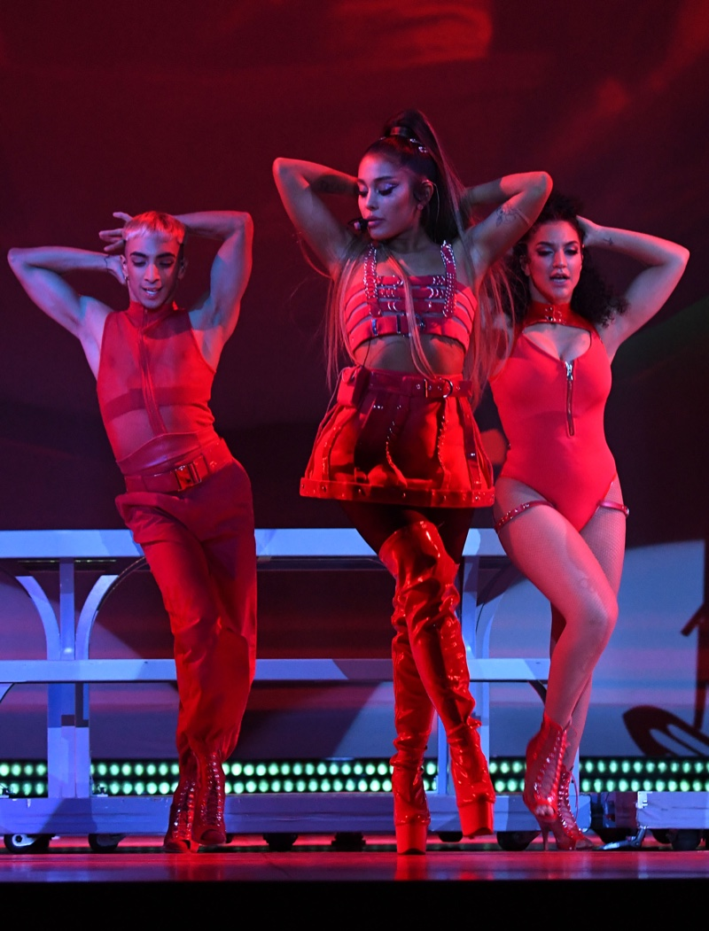 Dressed in red, Ariana Grande wears bondage inspired look from Versace on Sweetener World Tour. Photo: Kevin Mazur/Getty Images for Ariana Grande