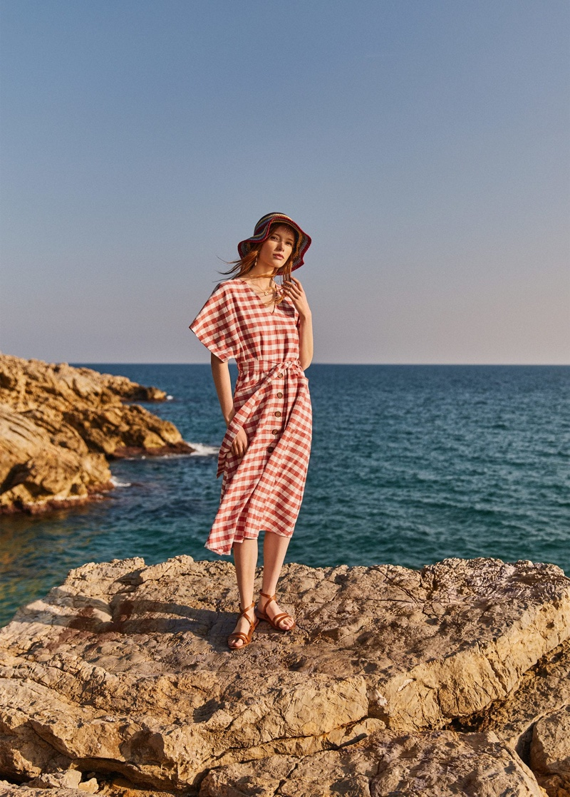 Posing near the beach, Julia Hafstrom models Mango's linen pieces